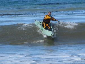 kayak surfing with a stable kayak from santa cruz kayaks