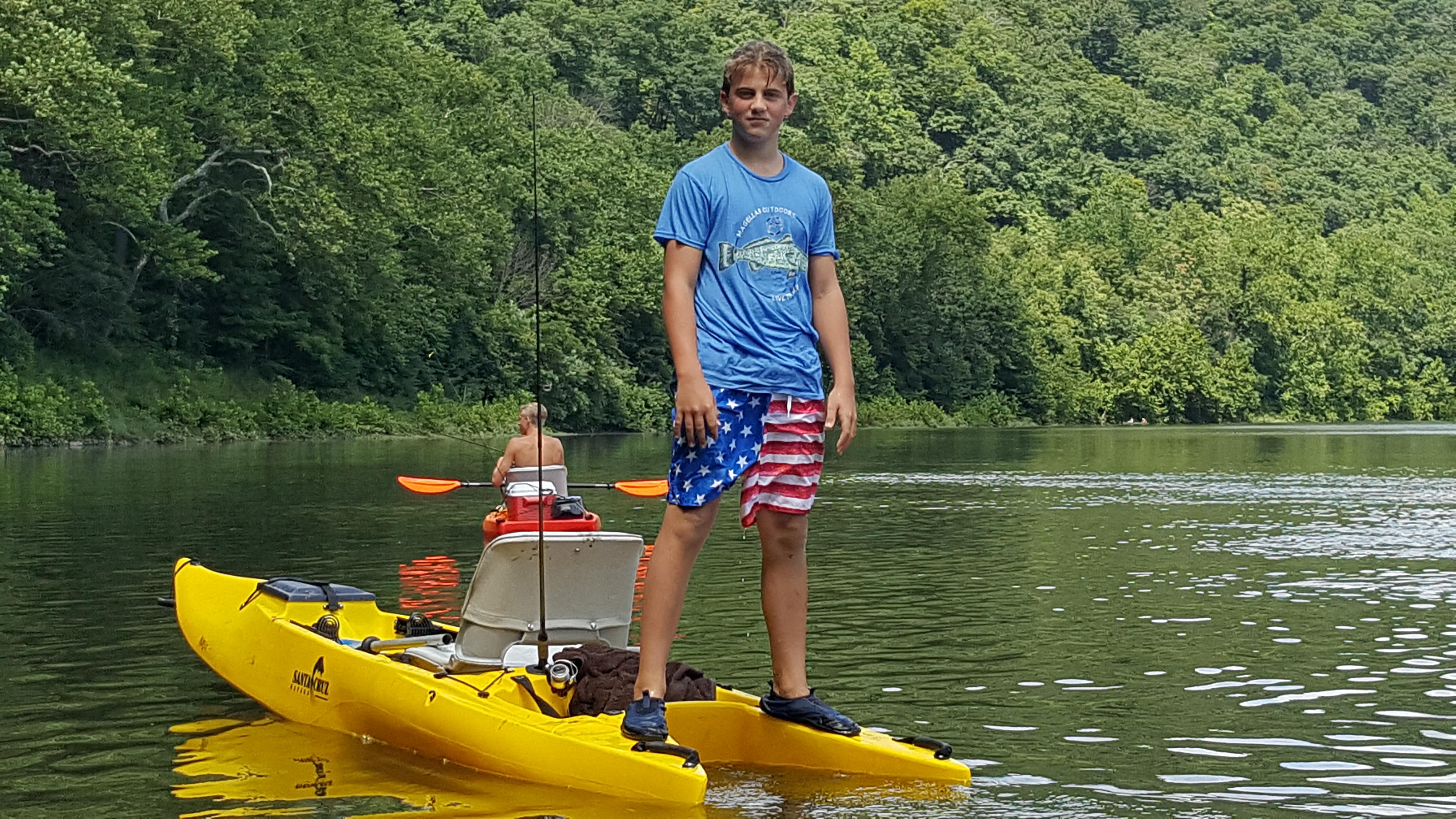 standing on a fishing kayak