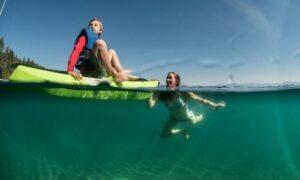 swimming alongside a kayak